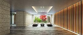 川越の伝統をモチーフとした、エレガントなラウンジ。エントランスを抜けた先に広がる、存在感のあるタイルの床と石壁で彩られたラウンジ。