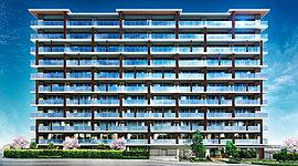 建物は、「空を感じるヴィラ」をコンセプトにデザイン。高台のこの地にふさわしい、周辺の緑や青空に映える美しい佇まいをめざしました。外壁はアースカラーとホワイトを基調とし、手すりには、眺望とプライバシーに配慮した高透過の乳白ガラスを採用。
