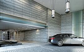 格式高き迎賓の空間。ガラスと石のオブジェ、そして乱貼石の床が、邸宅へ静かにエスコートする。