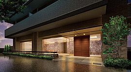 外とエントランスホールを隔てるガラスには、 方立のない1枚ガラスを採用し、広がりと開放感、上質感を演出。
