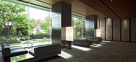 邸内に広がるのは、洗練されたモダニズムが凛とした空気を演出するエントランスラウンジ。スタッコ仕上げの意匠壁や木調の天井など、細部にまで息づく空間美が邸宅の矜持を感じさせます。