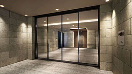 私的な領域へと誘う空間。住まう人を迎え、プライベートな領域との結界となるエントランス。邸宅としての格を意識して、上質と重厚感に満ちた空間に仕立てています。