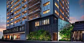 重厚な鋼板とガラスが織り成す大型の壁面、1階から2階に連なる植栽などスケール感のある佇まいが街並みに新しい彩りを添えます。1階には商業施設を取り入れ記憶に残る街の風景を継承。ウィンドウに映し出される店の賑わいが都市の華やぎを生み出します。