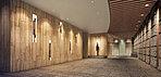 御影石の柱、アクセントウォールから構成された迎賓の空間。お住まいの方をエレベーターホールまで心地よくエスコートすることをテーマに、木目調の天井にはゆるやかな曲線のデザインを。