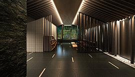 エントランスホールには仙台石とも呼ばれる、「稲井石」(石巻産)を中心とし、タイル、木調ルーバーなど厳選した素材を採用。また職人の手によって表情を与えられた、屏風のようなパネルが空間を演出しています。