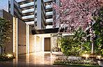 柔らかに煌めく光壁と、木々の色彩が出迎えるメインエントランス。住まいの品格を代弁するメインエントランスには幾重にも植栽を重ねた前庭を配置。