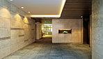 スクエアで端正な印象のエントランスホール。タイルの床面と天然石などによる壁面で彩り、柔らかな間接照明が空間を照らし出し、外出、帰宅の度に心地よい上質感に包まれます。