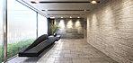 エントランスホールは、ワイドなガラススクリーンで囲まれ、大判タイルの受け壁が印象的な奥行感ある上質な空間に。アプローチの壁はせっ器質のボーダータイルを使用し、アートのようなモダンなソファーと、グリーンアレンジメントで飾られた 美しさと安らぎを演出。心地よく見送られ、温かく出迎えてくれる空間を創り上げます。