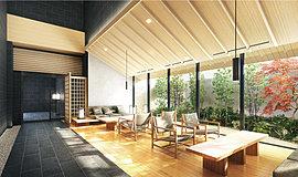 """開放的な2層吹抜の空間に、あえて傾斜屋根を設け目線を低く抑えた、落ち着けるラウンジ。額縁ともいえるウィンドウの先は、季節を謳う樹と常緑樹が調和する砂利敷きの坪庭。日本家屋の「廊下と庭の関係」を体現した""""広い縁側""""は、私領域との結節点です。"""