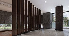 エントランスホールは、迎賓空間にふさわしく、晩翠通の銀杏並木をイメージした列柱とボーダータイルで、端正で広がりを感じさせる表情をつくりあげています。