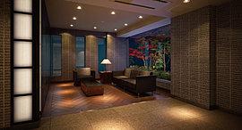 邸内に歩を進めると静穏なラウンジに。木調の床が温もりを感じさせ、光壁がアクセントとなって語らいの時を安らぎで満たします。
