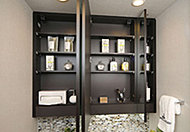 化粧品などの整理に便利な収納スペースを三面鏡の裏側に設置。カウンターまわりをすっきりと整理できます。