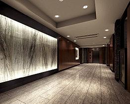 エントランスホールは、竹をモチーフとしたデザインが印象的な入口正面の光壁や、天然木の壁など、美の中に自然の優しさ、柔らかさが感じられる空間としました。