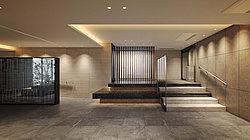 無駄な装飾を用いず、素材の質感や光の演出によって、美しい余白をデザインしたエントランスホール。四季の演出装置ともなる「アートステージ」や「映り込みの壁」が、空間に洗練されたアクセントを添えます。