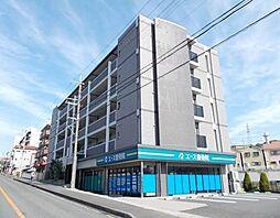 大阪府寝屋川市梅が丘1丁目の賃貸マンションの外観
