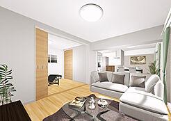 建具と床材は自然の木の風合い漂う木目柄でコーディネートした温かみのある住空間です。リビングに隣接する洋室2 には引戸を採用し、用途に合わせて空間をフレキシブルに活用できます
