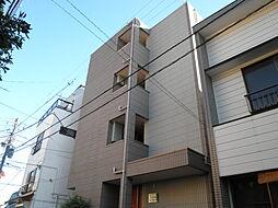 エスコートK[3階]の外観