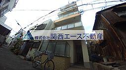新礒田マンション[1階]の外観
