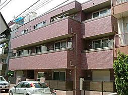 リアライズ 西原の閑静な住宅街に位置する外観タイル貼りマンシ[2階]の外観